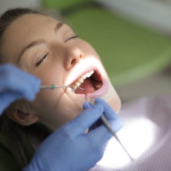 Dentist Examing teeth in Katy Texas